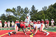ORADELL, NJ - September 18: Practices are very intense, both defense and offenses would consistently battle - this is what you would expect and want from such a high-level program. <br /> <br /> Coach Vito sets the tone from the first whistle as he calls upon the 'Saigon Drill' to start off practice on September 18,2020 in Oradell, New Jersey. <br /> <br /> We are in the midst of witnessing something this world has never experienced - a global pandemic. The coronavirus has swept away the world in March of 2020 - since then, the world we know It hasn't been the same. Jobs, businesses and futures have been put on hold and lost, yet, we have to power through to overcome one of the greatest obstacles this we have faced. The high school football season wasn't suppose to happen, but a glimmer of hope, intense safety measures & a little bit of luck has allowed for the season to start, now the question is ' Can It be completed?'<br /> <br /> Photo by Johnnie Izquierdo