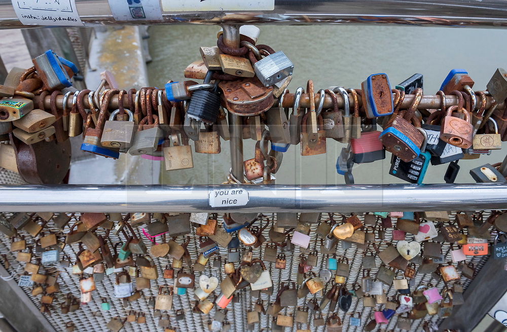 © Licensed to London News Pictures; 09/02/2021; Bristol, UK. Hundreds of 'love locks', padlocks with names or initials written on them which are meant to symbolise love and have appeared on bridges in major towns and cities across Europe, are seen fixed to Pero's Bridge which spans part of Bristol Harbourside. Alex Hartley, a Lib Dem candidate for the nearby ward of Hotwells and Harbourside, has started a petition for the locks to be cut from the bridge, which intended to be a memorial to the victims of slavery. Photo credit: Simon Chapman/LNP.