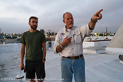 Keith Ball showing Sean Lichter the view from the roof of Bikernet's World HQ in Wilmington, CA. Wednesday, June 20, 2018. Photography ©2018 Michael Lichter.