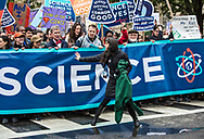 Beka Economopoulos guiding the March for Science along Constitution Avenue in Washington, D.C., on Earth Day.