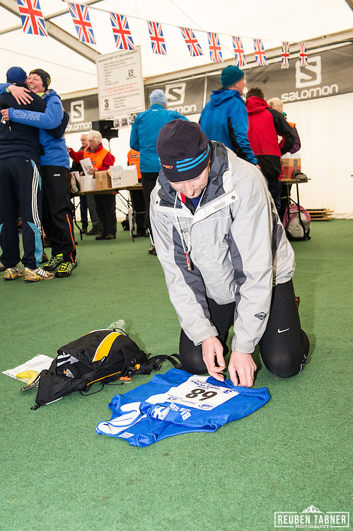Runner 68, Jonathan Bridge pins on his number prior to the 60th Yorkshire Three Peaks Race.