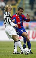 BOLOGNA, 22/02/2004<br />PARTITA DI SERIE A BOLOGNA-JUVENTUS 0-1<br />PAvel Nedved (Juventus) and Tomas Locatelli (Bologna)<br />FOTO CARLO BARONCINI/GRAFFITI