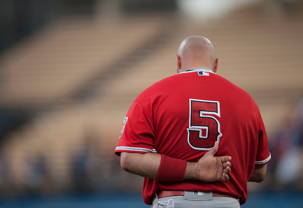 Albert Pujols listens to the National Anthem before the start of the Angels' Freeway Series game against the Dodgers Thursday night at Dodger Stadium.<br /> <br /> ///ADDITIONAL INFO:   <br /> <br /> freeway.0401.kjs  ---  Photo by KEVIN SULLIVAN / Orange County Register  --  3/31/16<br /> <br /> The Los Angeles Angels take on the Los Angeles Dodgers at Dodger Stadium during the Freeway Series Thursday.<br /> <br /> <br />  3/31/16