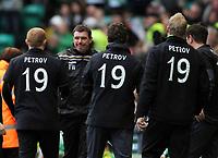 Football - Scottish Premier League -  Celtic vs. St. Johnstone<br /> <br /> The Celtic management wear track tops in tribute to Stan Petrov during the Celtic vs. St. Johnstone Scottish Premier League match at Celtic Park, Glasgow on April 1st 2012<br /> <br /> Ian MacNicol/Colorsport