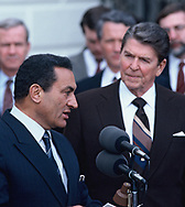 President Ronald Reagan listens to Egyptian president  Hosni El Sayed Mubarak during department statements at the Diplomatic Entrance of the White House on March 12, 1985<br /> <br /> Photograph by Dennis Brack