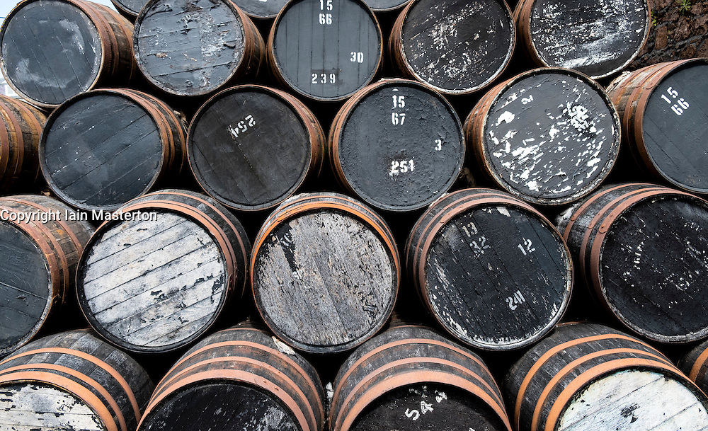 Empty whisky barrels at whisky distillery in Scotland, United Kingdom