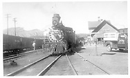 """D&RGW #315 renumbered #15 with diamond stack and big headlight.  Movie train for """"Colorado Territory.""""  Depot is signed """"Aztec.""""<br /> D&RGW  Durango, CO  9/21/1948<br /> In book """"Hollywood's Railroads: Vol. 3 - Narrow Gauge Country"""" page 11"""