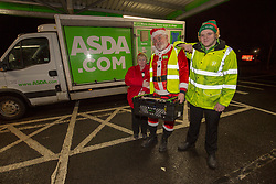 Andy Law, the Dundee Asda delivery driver that has become a hit with customers after dressing up as Santa. Pic with colleagues Dawn McCann and Cameron Watt.