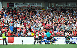 Brentford players and the crowd celebrate Tommy Smith's goal - Photo mandatory by-line: Patrick Khachfe/JMP - Mobile: 07966 386802 09/08/2014 - SPORT - FOOTBALL - Brentford - Griffin Park - Brentford v Charlton Athletic - Sky Bet Championship - First game of the season