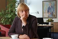 21 AUG 2003, BERLIN/GERMANY:<br /> Angela Merkel, CDU Bundesvorsitzende und Vorsitzende der CDU/CSU Bundestagsfraktion, waehrend einem Interview, in ihrem Buero (im Hintergrund ein Bild von Konrad Adenauer), Jakob-Kaiser-Haus, Deutscher Bundestag<br /> IMAGE: 20030821-01-020