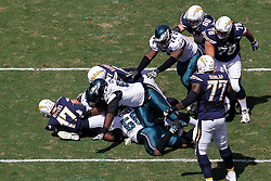 San Diego Chargers quarterback Philip Rivers #17 is sacked during the NFL game between the San Diego Chargers and the Philadelphia Eagles in Philadelphia. The Chargers won 33-30. (Photo by Brian Garfinkel)
