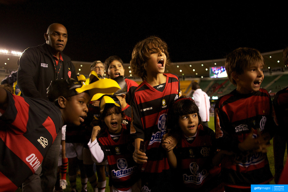 Young Flamengo fans, creating a guard of honour for the players, react as they see their hero's emerging from the dressing room during the Flamengo V  Ceara, Futebol Brasileirao  League match at the Jornalista Mário Filho Stadium, Rio de Janeiro,  Brazil. 14th August 2010. Photo Tim Clayton.