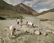 A doctor and his staff crossing the Garam Cheshma glacier river (near Boroghil pass, on the Afghan border), to bring medicine to the Garam Cheshma village, a remote Ismaili village.