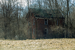 Old abandoned house in a sad state of disrepair.