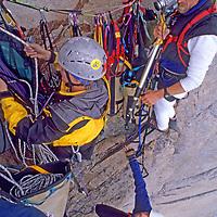 BAFFIN ISLAND, Nunavut, Canada. John Catto films Jared Ogden & Mark Synnott (MR) high on 4000' granite face of Great Sail Peak, an Arctic big wall climb.