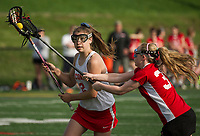 Laconia's Bella Daly looks for a shot with pressure by Campbell's Autumn Thompson during NHIAA division III Lacrosse Wednesday afternoon. (Karen Bobotas/for the Laconia Daily Sun)