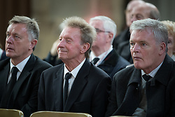 """© Licensed to London News Pictures . 14/10/2013 . Gorton Monastery , Manchester , UK . Footballers DENIS LAW (c) and GORDON McQUEEN (r) amongst mourners . The Humanist funeral of photographer Harry Goodwin , attended by footballers and other celibrities and featuring music by artists he had photographed including """"He Ain't Heavy, He's My Brother"""" by the Hollies and """" Happiness """" by Ken Dodd . Photo credit : Joel Goodman/LNP"""