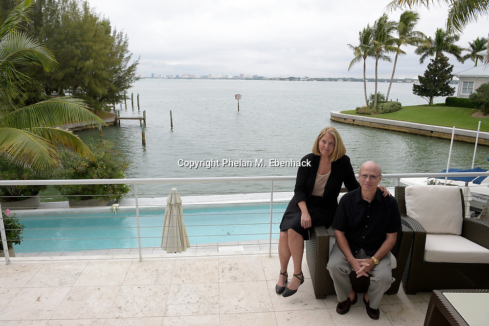 Dr. Joel Morganroth, right, and his wife Dr. Gail Morrison Morganroth sit on the main floor balcony of their home with a view of Sarasota Bay in Sarasota, Fla., Tuesday, Dec. 30, 2014. The balcony sits on the second floor of the home and is reminiscent of the bow of a boat. The home was designed to take advantage of the water view, where dolphins can be seen regularly swimming behind the house. (Photo by Phelan M. Ebenhack)