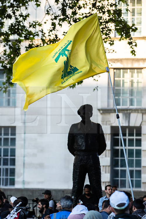 © Licensed to London News Pictures. 10/06/2018. London, UK. A Hezbollah flag is flown opposite Downing Street in Whitehall , during the annual Al Quds day march in support of the Palestinian cause, in central London. Photo credit: Joel Goodman/LNP