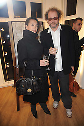 MIKE FIGGIS and ROSEY CHAN at a private view of photographs held at the Little Black Gallery, Park Walk, London on 20th January 2010.