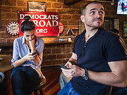 09 NOVEMBER 2016 - BANGKOK, THAILAND:   Members of Democrats Abroad Thailand watch election results come in Wednesday morning (Thai time). Democrats Abroad Thailand met at the Roadhouse Barbecue, an American restaurant in Bangkok, to watch election results come in. It was a somber election watch party as what was expected to be a Clinton victory turned into a Trump win.    PHOTO BY JACK KURTZ