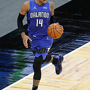 ORLANDO, FL - APRIL 18: Gary Harris #14 of the Orlando Magic dribbles the ball up the court against the Houston Rockets during the first half at Amway Center on April 18, 2021 in Orlando, Florida. NOTE TO USER: User expressly acknowledges and agrees that, by downloading and or using this photograph, User is consenting to the terms and conditions of the Getty Images License Agreement. (Photo by Alex Menendez/Getty Images)*** Local Caption ***  Gary Harris