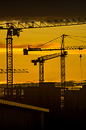 Silhouettes of construction cranes for the evening sky in Friedrichshain, Berlin 2017.