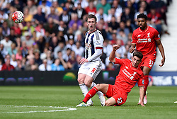 Cameron Brannagan of Liverpool tackles Craig Gardner of West Bromwich Albion  - Mandatory by-line: Joe Meredith/JMP - 15/05/2016 - FOOTBALL - The Hawthorns - West Bromwich, England - West Bromwich Albion v Liverpool - Barclays Premier League