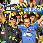 Fenerbahce's supporters shows the Fenerbahce and Erzurumspor team flag during their Turkish Super Cup 2012 soccer derby match Galatasaray between Fenerbahce at the Kazim Karabekir stadium in Erzurum Turkey on Sunday, 12 August 2012. Photo by TURKPIX