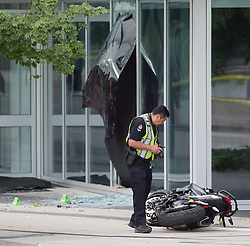 """A police officer examines a motorcycle after a female stunt driver working on the movie """"Deadpool 2"""" died after a crash on set, in Vancouver, BC, Canada, on Monday August 14, 2017. Vancouver police say the driver was on a motorcycle when the crash occurred on the movie set on Monday morning. Photo by Darryl Dyck/CP/ABACAPRESS.COM"""