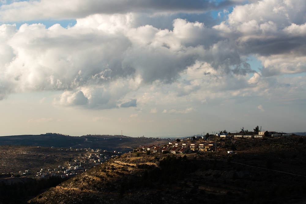 Permanent and temporary houses are seen on a hilltop at the West Bank Jewish settlement of Eli, located south of the Palestinian West Bank town of Nablus, on January 1, 2017.