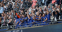 Chelsea's Gary Cahill (centre) lifts the FA Cup trophy with his team-mates