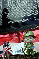 """229 June 2008: The Moving Wall, a traveling replica of the Vietnam Memorial in Washington, D.C., is displayed in Normal Illinois.  The display grounds also had other exhibits including a Vietnam era helicopter and a replica of the statue """"Fallen Soldier""""."""