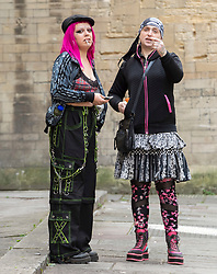 """© Licensed to London News Pictures; FILE PICTURE 22/06/2021; Bristol, UK. YASMIN SCHNEIDER (with pink hair) arrives at Bristol Crown Court. Yasmin Schneider is charged with two counts of outraging public decency and is one of the defendants facing charges related to a """"Kill the Bill"""" protest and riot against the Police, Crime, Sentencing and Courts Bill. During the protest on 21 March 2021 two police vehicles were burnt out and windows on Bridewell Police Station were smashed. The Police, Crime, Sentencing and Courts Bill proposes new restrictions on protests. Photo credit: LNP."""