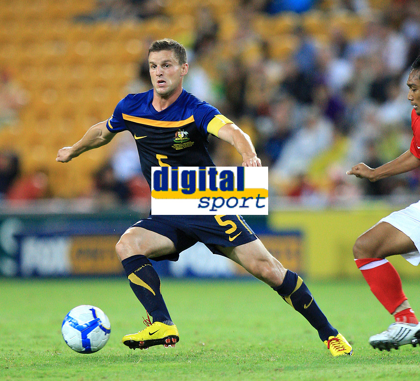 """AUSTRALIA V INDONESIA - 3RD MARCH 2010. Action from the Asian Cup qualifier between the Australian """"Qantas Socceroo's"""" v Indonesia, played at Suncorp Stadium in Brisbane, Queensland, Australia. PHOTO : SCOTT POWICK / SMP IMAGES / DPPI - JASON CULINA (AUS)"""