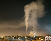 View over polluting cement factory in Dorud city, Lorestan province. <br /> The building industry is responsible for a big part of the air pollution worldwide. Iran