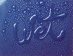 "the word ""wet"" drawn with water on a shiny blue surface surrounded by water droplets"