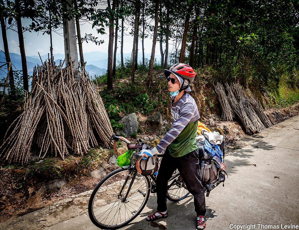 A Vietnamese man rides his bicycle in the Central Highlands.