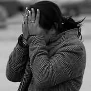 A woman covers her eyes from a murder scene where a family member was killed during drug related violence in Ciudad, Juarez, Mexico..(Credit Image: © Louie Palu/ZUMA Press).December 2011
