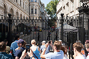 On the day Conservative MP Boris Johnson is announced as the new Prime Minister of the United Kingdom, tourists gather outside Downing Street on the 23rd July 2019 in the United Kingdom. Downing Street is a street in London that houses the official residences and offices of the Prime Minister of the United Kingdom and the Chancellor of the Exchequer.