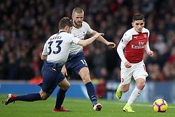Tottenham Hotspur's Ben Davies (left) and Eric Dier, (centre) battle for the ball with Arsenal's Lucas Torreira