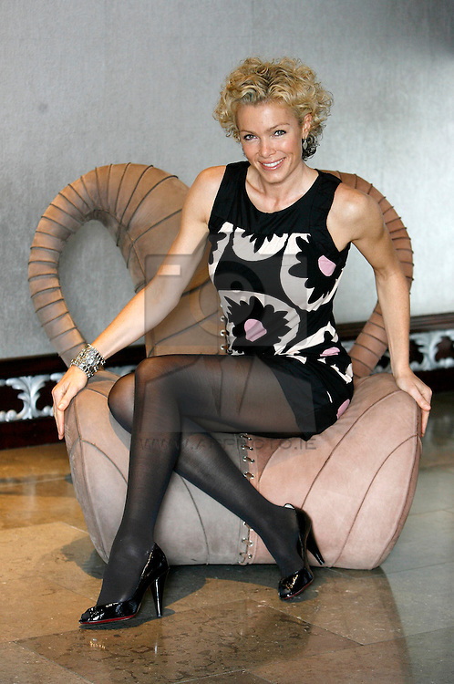 Fitness queen and stunning UK model Nell McAndrew is pictured at the launch of YSX Rapid Action Solutions - a fabulous new range of natural active formulas for the face and body that give fast results. Pic Andres Poveda