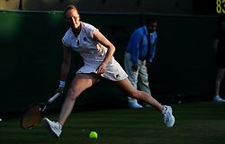 LONDON, July 6, 2018  Alison Van Uytvanck of Belgium competes during the women's singles second round match against Garbine Muguruza of Spain at the Wimbledon Championships 2018 in London, Britain, July 5, 2018. Alison Van Uytvanck won 2-1. (Credit Image: © Shi Tang/Xinhua via ZUMA Wire)