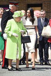 Queen Elizabeth II and the Duchess of Sussex during a walk about in Chester.