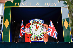 © Licensed to London News Pictures. 13/05/2018. LONDON, UK. A puppeteers stall at the Covent Garden May Fayre at St Paul's Church, Bedford Street, known as the actors' church.  Now in its 43rd year, Punch and Judy professors and puppeteers celebrate the art of puppetry on Mr Punch's 356th birthday, near to where writer Samuel Pepys first saw Mr Punch in May 1662.  Photo credit: Stephen Chung/LNP