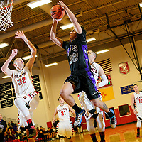 022514  Adron Gardner/Independent<br /> <br /> Miyamura Patriot Jared Meese (32), right, beats Grants Pirate Richie Lucero (32) to the hoop for a layup at Grants High School in Grants Tuesday.