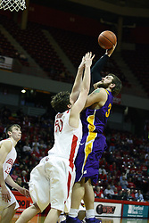 12 January 2011: Blake Mishler allows Lucas O'Rear to get off a one handed shot from in front of the basket  during an NCAA Missouri Valley Conference men's basketball game between the Northern Iowa Panthers and the Illinois State Redbirds at Redbird Arena in Normal Illinois.