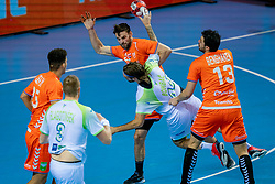 The Dutch handball player Jorn Smits, Samir Benghanem (r) in action against Dean Bombac from Slovenia during the European Championship qualifying match on January 6, 2020 in Topsportcentrum Almere
