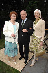 Left to right, LADY ELIZABETH ANSON, actor and Oscar winning screenwriter JULIAN FELLOWES and his wife EMMA KITCHENER-FELLOWES at a reception for the Friends of The Castle of Mey held at The Goring Hotel, London on 20th May 2008.<br /><br />NON EXCLUSIVE - WORLD RIGHTS