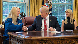 President Donald Trump shakes hands with NASA astronaut Kate Rubins, as First Daughter Ivanka Trump looks on, during a video conference where President Donald Trump talked with NASA astronauts Peggy Whitson and Jack Fischer onboard the International Space Station Monday, April 24, 2017 from the Oval Office of the White House in Washington. The President congratulated Whitson for breaking the record for cumulative time spent in space by a U.S. astronaut. The President and First Daughter also discussed with the three astronauts what it is like to live and work on the orbiting outpost as well as the importance of STEM.  Photo Credit: (NASA/Bill Ingalls)